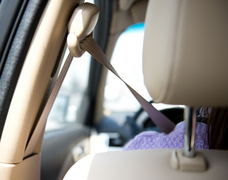 always: Girl in a car with the seatbelt always fasten. Stock Photo