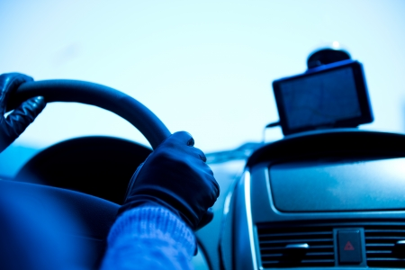 Female drivers hands on steering wheel inside of a car, using a satelite navigationGPS.  photo