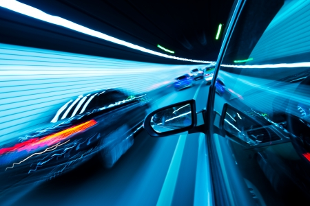 time drive: View from Side of high-speed car in the tunnel, Motion Blur Stock Photo