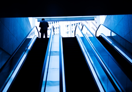 Low angle view looking to top of modern escalator with blue tone. Stock Photo - 22993977