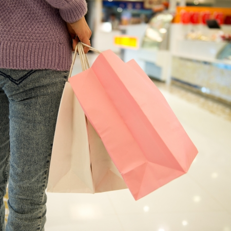 woman in shopping mall with bags.  photo