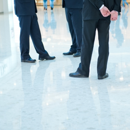 Low section of three businesspeople standing together. photo
