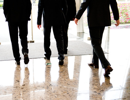 Low section of businesspeople walking together. photo