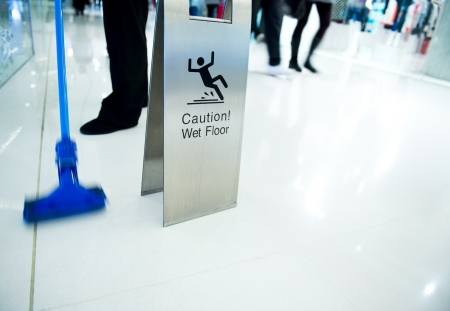 cleaning in progress, and wet floor caution sign besides. Stock Photo - 22994129