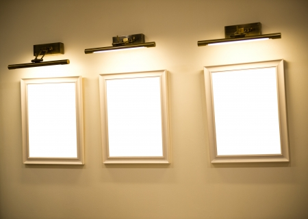 Group of picture frames on beige wall. photo