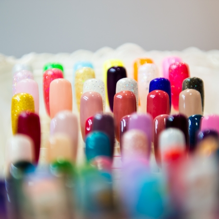 big collection of colorful nail samples. photo
