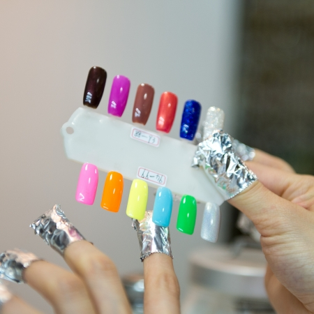 contrastive: Woman in a beauty salon making nails.