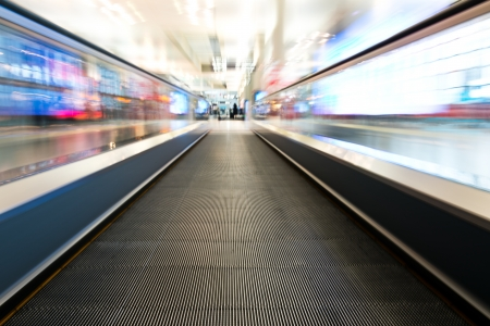 moving forward: moving escalator of walkway in the airport. Stock Photo