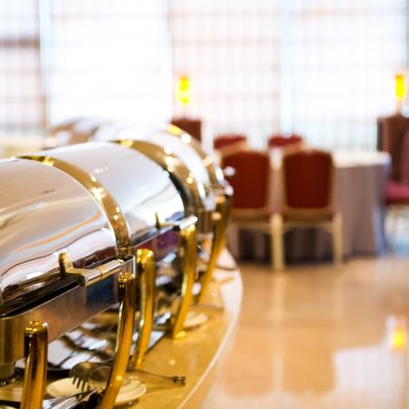Many buffet heated trays ready for service.