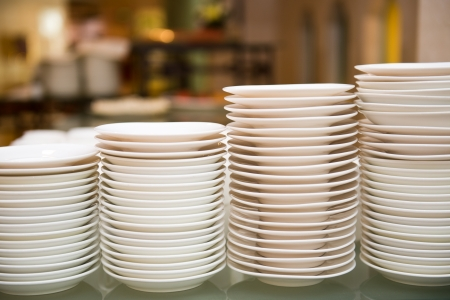 buffet table: Group of white plates stacked together. Stock Photo