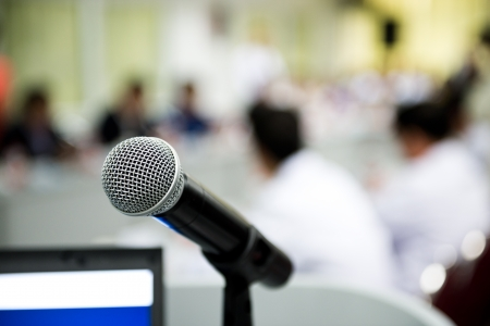 Closeup microphone in conference room with blur person. photo