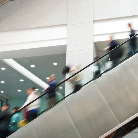 Business people on escalator.Blurred motion  photo