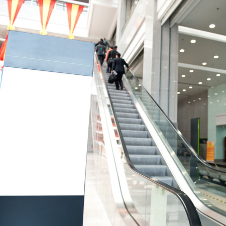 Business people on escalator.Blurred motion
