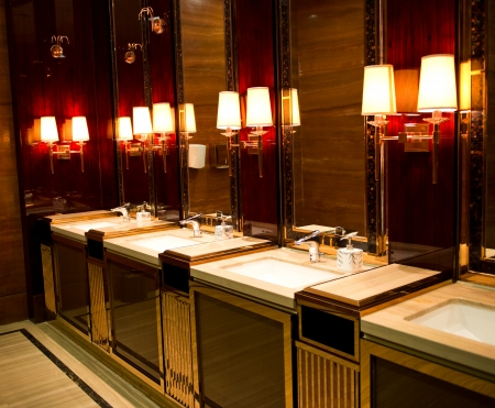 public toilet: sinks and taps in a luxury public toilet.
