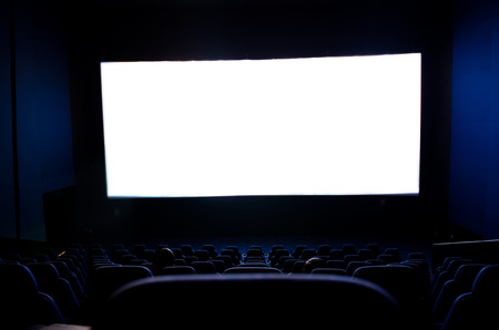 Dark movie theatre interior. screen and chairs. photo
