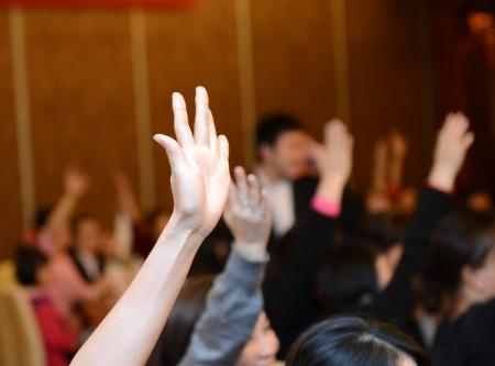 hands raised: Raised hands in class of university  Stock Photo