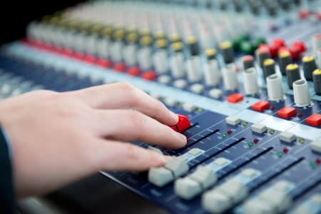 Hand on a sound mixer. photo