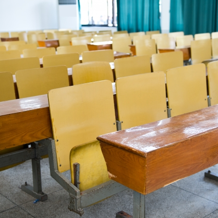 lecture room: desk and chairs in classroom. Editorial