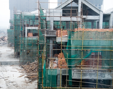 Construction site of house with scaffolding.