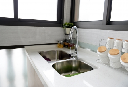 Interior of a modern kitchen with stanless steel double sink. Stock Photo