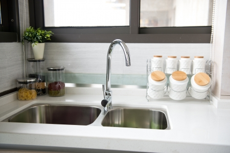 double sink: Interior of a modern kitchen with stanless steel double sink. Stock Photo
