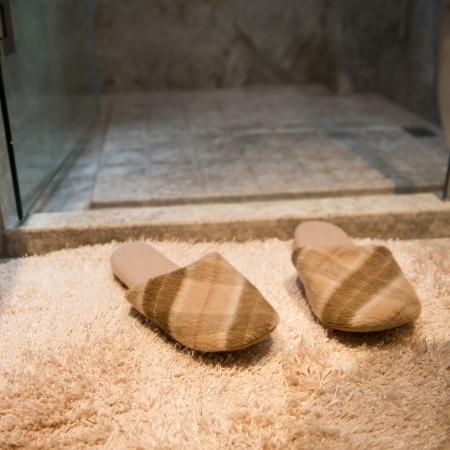 slipper: Slippers on the floor of hotel bathroom.