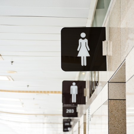 Toilet sign on the wall. Stock Photo