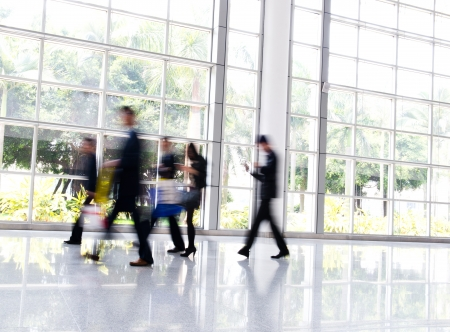 people in office: Business people rushing in the lobby. motion blur