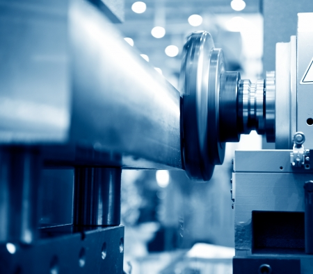 on the lathe: Close-up of a CNC machine at work.