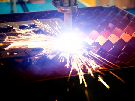 Industrial laser cutter with sparks. Stock Photo - 23534261