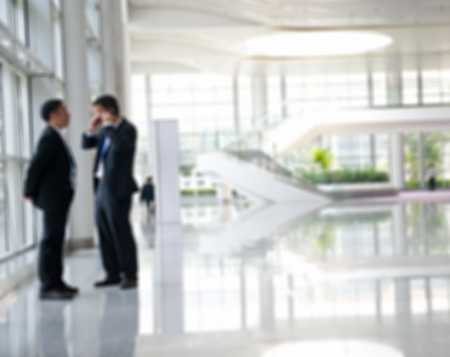 out of focus: two businesspeople standing together. out of focus Stock Photo