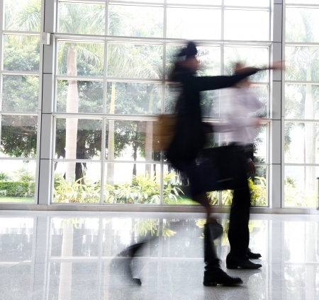 moving office: Business people rushing in the lobby. motion blur