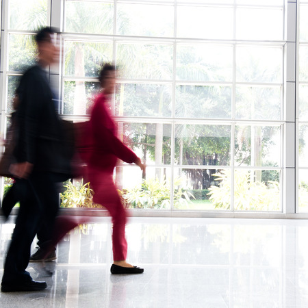 Business people rushing in the lobby. motion blur photo