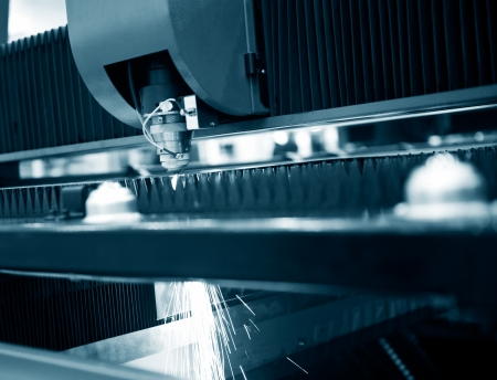 Industrial laser cutter with sparks. Stock Photo - 23563019
