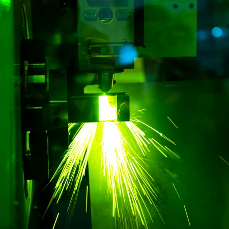 Industrial laser cutter with sparks. Stock Photo - 23563025