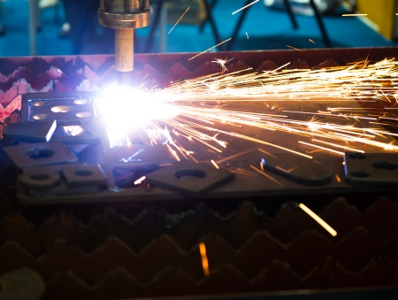 Industrial laser cutter with sparks. photo