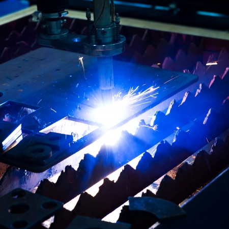 Industrial laser cutter with sparks. Stock Photo - 23563115