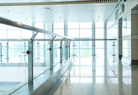 handrail: empty long corridor in the modern office building.