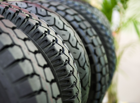tyre tread: Group of  new tires for sale at a tire store. selective focus.