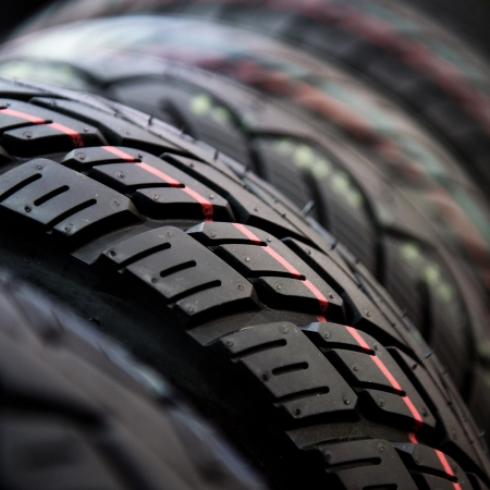 Group of  new tires for sale at a tire store. selective focus. photo