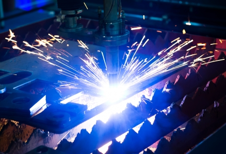 Industrial laser cutter with sparks. Stock Photo - 23534316