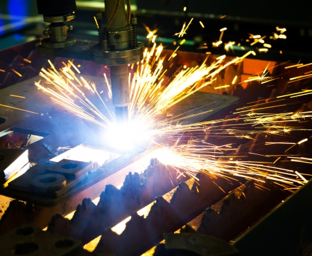 Industrial laser cutter with sparks. Stock Photo - 23534318
