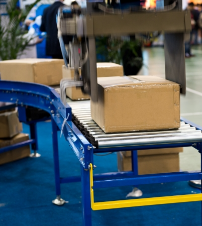 package boxes on industrial conveyor line.  photo