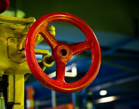 main gate: Red valves of pressure equipment in industrial facility. Stock Photo