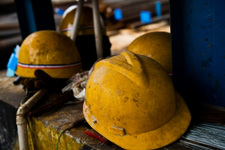greasy: Some construction helmets on work place. Stock Photo