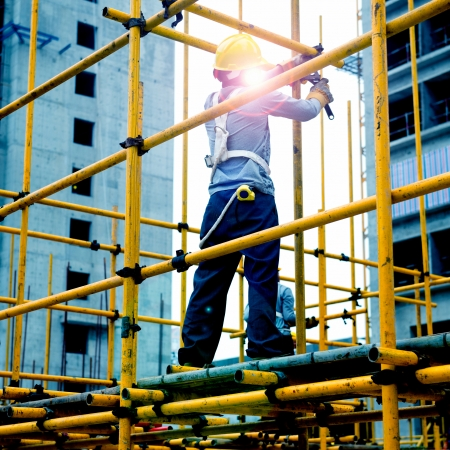 light worker: Construction workers working on scaffolding