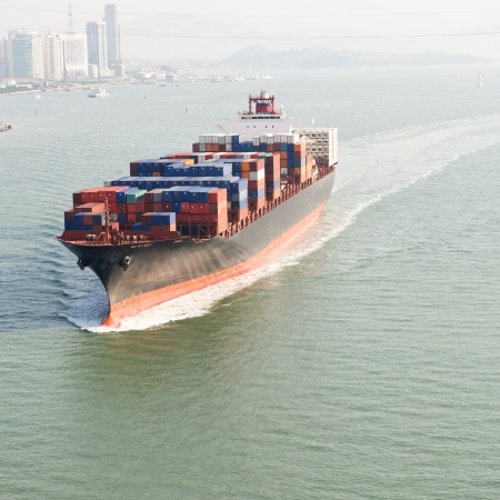 intermodal: Large container ship arriving in port.