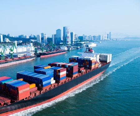 cargo container: Large container ship arriving in port.