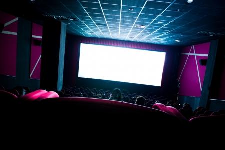 Dark movie theatre interior. tilted screen, chairs