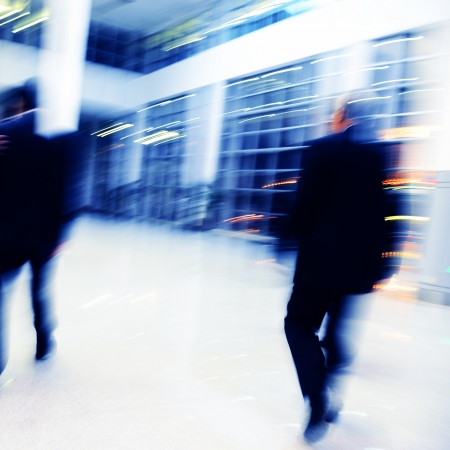 business traveler: Blur motion of businesspeople walking together.